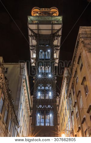 Front View Of Elevator Elevador De Santa Justa In Lisbon At Night Time. Historic Elevator In The Cit
