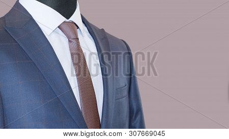 Mens Suit: Jacket, Shirt & Tie Isolated On A Mauve Background. Business Style. Elegant Clothes. Men