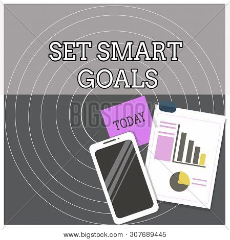 Text sign showing Set Smart Goals. Conceptual photo giving criteria to guide in the setting of objectives Layout Smartphone Off Sticky Notes Clipboard with Pie Chart and Bar Graph. poster