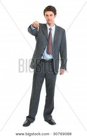 Full Length Portrait Of Modern Realtor Giving Keys