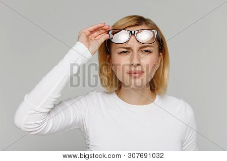 Woman Has Problems With Poor Eyesight, Squinting While Trying To See Something, Taking Off Glasses,