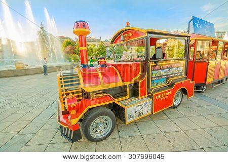 Braga, Portugal - August 12, 2017: Close-up Of Red Tourist Train At The Terminus In Republic Square