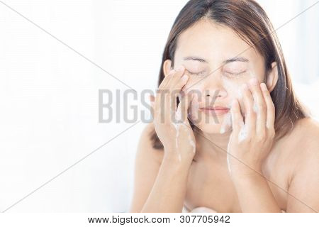 Close Up Woman Looking Reflection In The Mirror For Washing Face With Foam In The Bathroom, Health C