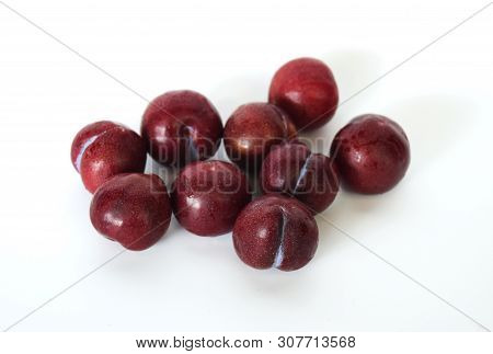 Plum (Prunus domestica L.) Healthy fruit concept White background
