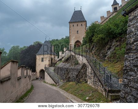 Karlstejn, Czech Republic - June 22 2019: Entrance To Gothic Karlstejn Castle With First Gate And Vo