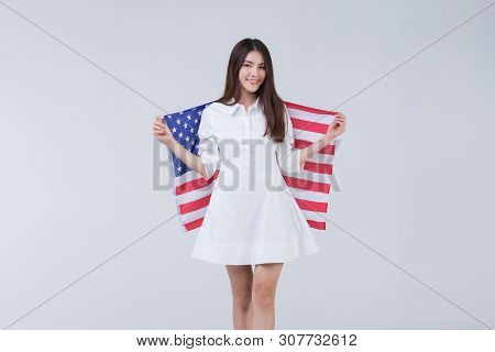 Young And Beautiful Happy Smile Face Asian Woman Holding And Covered By American Flag And Rise Over