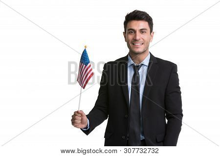 Smiling Caucasian Businessman In Black Suit Standing And Holding America Flag In His Hand, Isolated