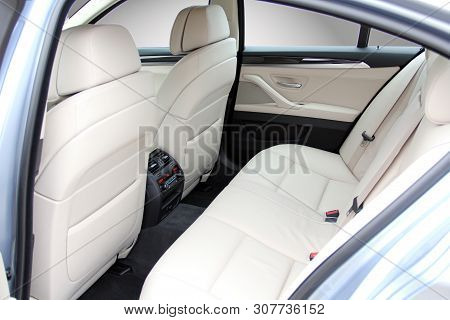 The White Rear Seat Of A Luxury Passenger Car