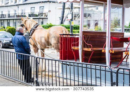 Douglas, Isle Of Man, June 16, 2019. The Douglas Bay Horse Tramway On The Isle Of Man Runs Along The