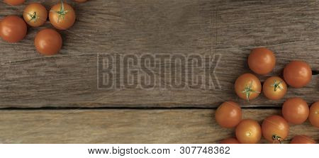 Group Tomato Place On The Wooden Table Use For Background. Cherry Tomatoes Is A Small That Has A Swe