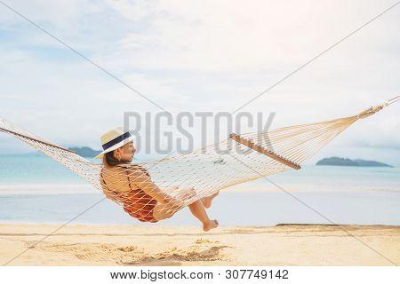 Asian Women Relaxing In Hammock Summer Holiday On Beach