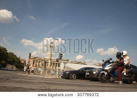Paris, France - July 06, 2018: Shot In Motion: Cars And Motorcycles Drive Along The Place De La Conc