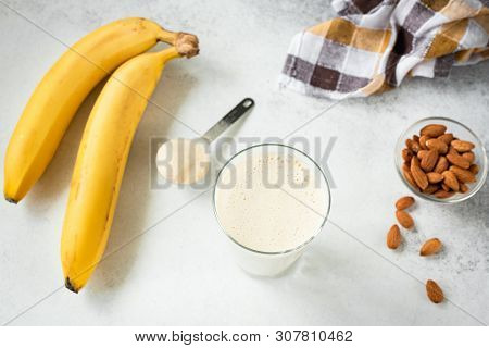 Banana Protein Shake Or Smoothie In Glass. Table Top View