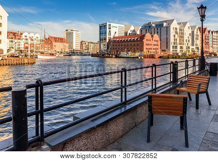 Gdansk, Poland - June 22, 2019: Benches On The Promenade With A View Of The Marina Of The Old Town O