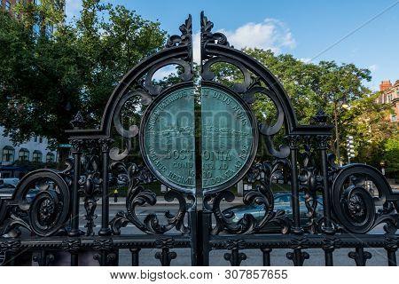 Boston, United States: October 2, 2017: Boston Public Garden Entry Gate With Traffic Behind