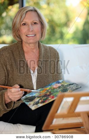 50 years old woman painting