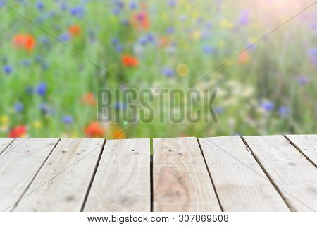 Summer Wooden Background With Nature Meadow Backdrop And Empty Space On Wood To Place Object.tif