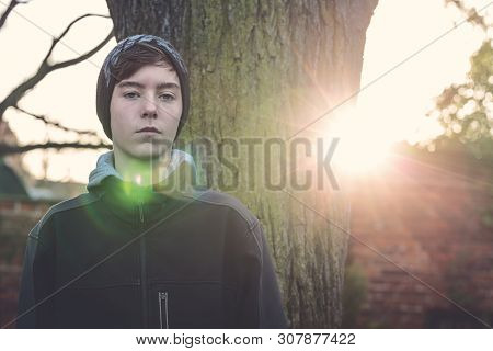 Portrait Of A Serious Young Man, Shot Against The Sun