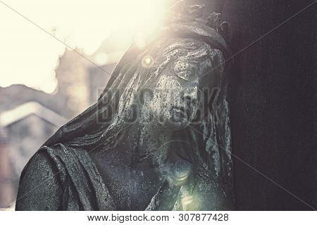 Backlight Shot With Flares, Sculpture Of A Sad Woman. Unknown Artist Of The 19th Century