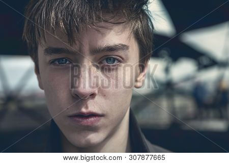 Portrait Of A Serious Young Man With Dark Colors