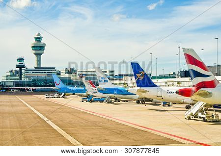 Amsterdam, Netherlands - April 11, 2012. Airplanes Parked On Schiphol Airport.