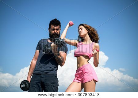 Start Daily Workout. Sexy Slim Active Couple With Straight Body Sportswear Outdoor Blue Sky Backgrou