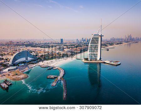 Dubai, United Arab Emirates - June 5, 2019: Burj Al Arab Luxury Hotel And Dubai Marina Skyline In Th