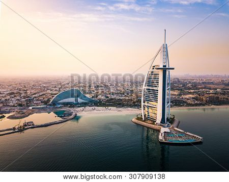 Dubai, United Arab Emirates - June 5, 2019: Dubai Seaside Skyline And Burj Al Arab Luxury Hotel Aeri