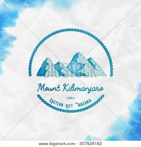 Kilimanjaro Logo. Round Trekking Turquoise Vector Insignia. Kilimanjaro In Eastern Rift, Tanzania Ou