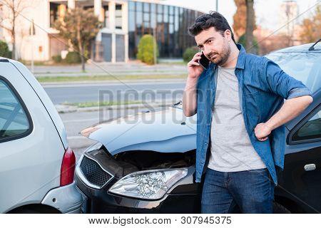 Man Calling Roadside Service After Car Crash