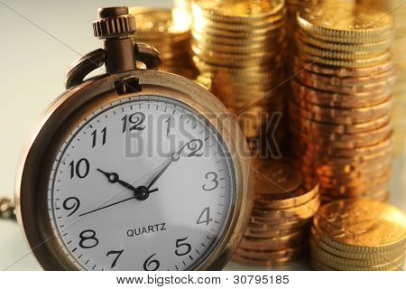 watch and pile of the coin
