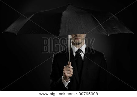 portrait man the beautiful man in black costume with blak umbrella special-service agent or body guard poster