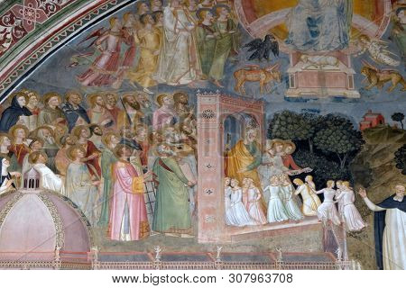 FLORENCE, ITALY - JANUARY 10, 2019: Souls entering into Heaven, detail of the Active and Triumphant Church, fresco by Andrea Di Bonaiuto, Santa Maria Novella Dominican church in Florence