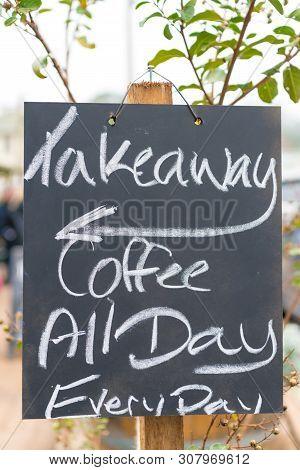 Takeaway Coffee Sign Written With Chalk On Blackboard