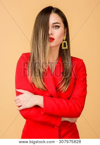 Woman Wear Glamorous Earrings. Hairstyle And Hairdresser. Ombre Hair Coloring Effect. Hair Care Prod