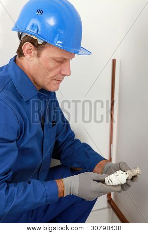 Plumber with a radiator valve