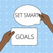 Writing note showing Set Smart Goals. Business photo showcasing giving criteria to guide in the setting of objectives Two Figured Tablets Signs Held in Hands One Above Other Text Space. poster