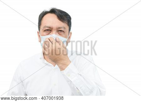 A Middle-aged Man Wearing A White Shirt, Wearing A Mask And Covering His Nose With His Hand. Protect