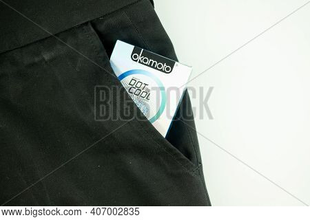 Samut Prakan, Thailand - February 7, 2021 : Box Of Okamoto Condoms In Black Slack Pants Pocket On A