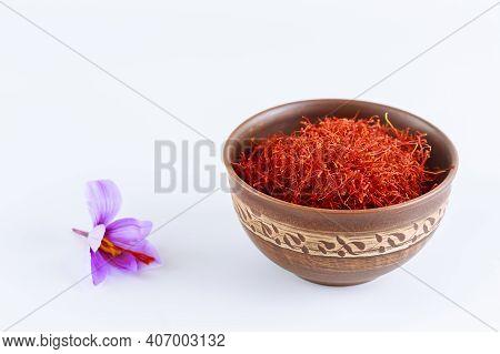 Single Saffron Flower And Saffron Thread In Ceramic Bowl On White. Crocus.