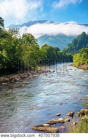 Mountain River Landscape In Summer. Wonderful Nature Scenery On Foggy Morning. Clouds Rolling Over T