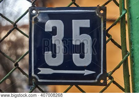 Weathered Grunge Square Metal Enameled Plate Of Number Of Street Address With Number 35
