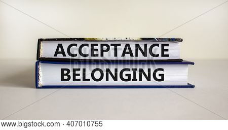 Acceptance And Belonging Symbol. Books With Words 'acceptance And Belonging' On Beautiful White Back