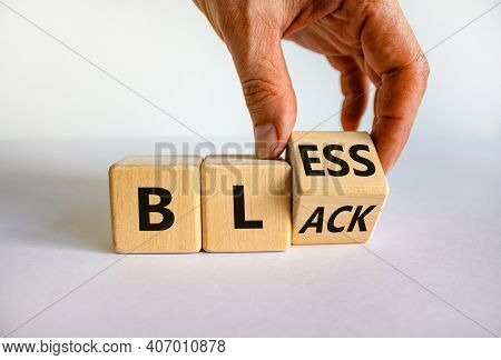 Bless Black Symbol. Hand Flips A Cube And Changes The Word 'black' To 'bless'. Beautiful White Backg