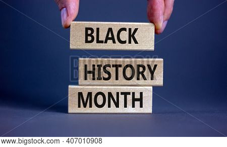 Black History Month Symbol. Wooden Blocks With Words 'black History Month'. Beautiful Grey Backgroun