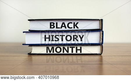 Black History Month Symbol. Books With Words 'black History Month'. Beautiful Wooden Table, White Ba