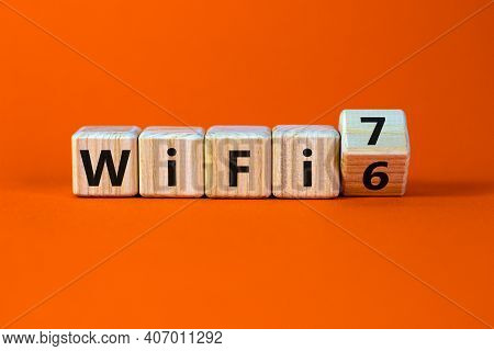 Wifi 6 Or 7 Symbol. Turned A Wooden Cube And Changed The Words Wifi 6 To Wifi 7. Beautiful Orange Ba