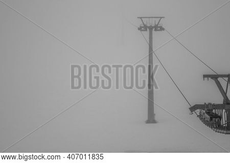 Pylon Of The Monte Falcone Chairlift Immersed In Fog On A Winter Day In Recoaro Mille, Vicenza, Ital