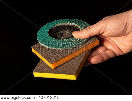 Builder Hand Holding Abrasive Tools Close Up On Isolated Black Background
