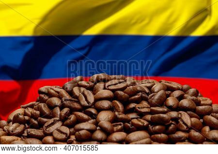 Roasted Coffee Beans On The Background Of The Colombian Flag. Concept: Best Flavored Coffee, Export